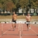 Two Athlets Run On Short Distance With Hurdles At The Stadium - VideoHive Item for Sale