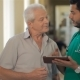 Doctor Shows Something On His Tablet To Senior Man - VideoHive Item for Sale