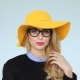 Young Woman In Glasses Smiling. In Yellow Hat - VideoHive Item for Sale