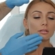Cosmetologist Stretches The Skin Over The Brow Of The Client - VideoHive Item for Sale