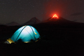 Illuminated Tourist Tent at Night on Background Erupting Volcano - PhotoDune Item for Sale