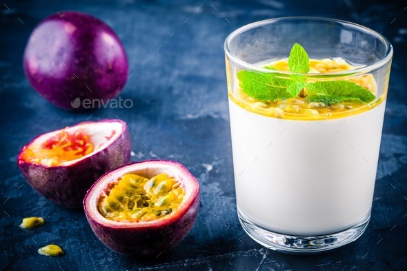 panna cotta dessert with passion fruit and mint - Stock Photo - Images