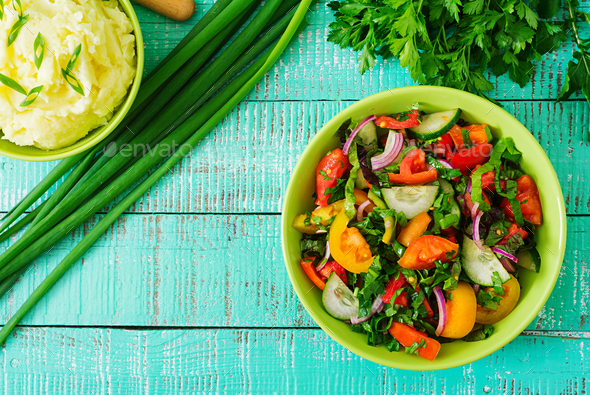 Fresh salad of tomatoes, cucumbers, peppers, arugula, red onion - Stock Photo - Images