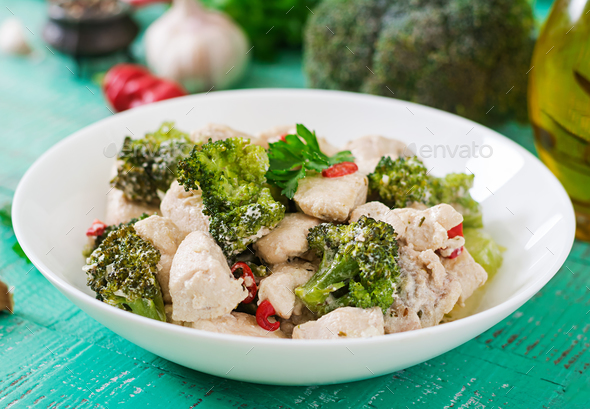 Delicate saute chicken with broccoli and chili peppers in a creamy garlic sauce - Stock Photo - Images