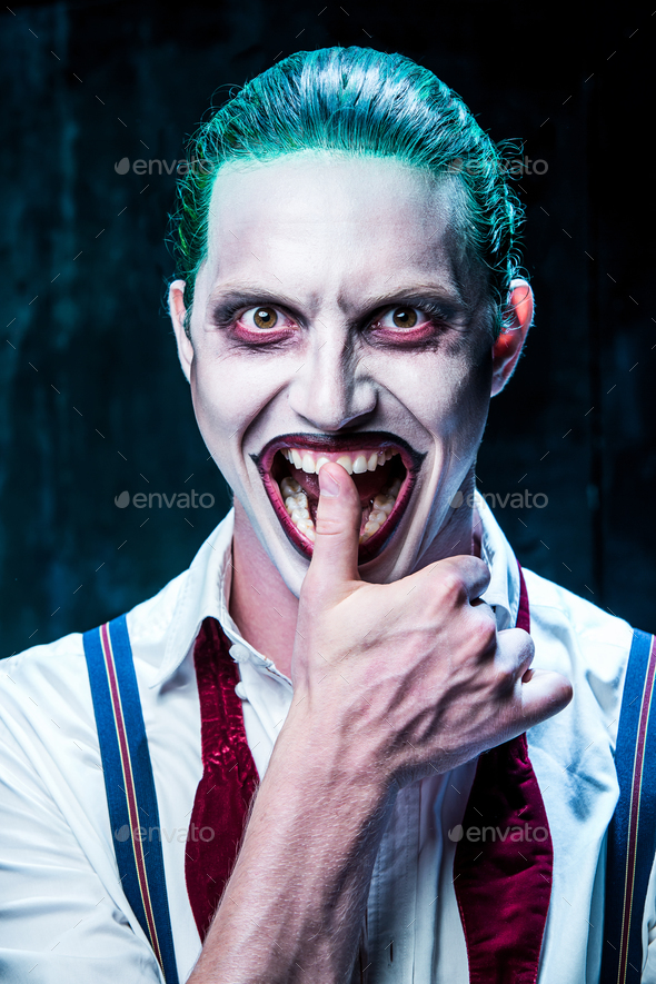 Bloody Halloween theme: crazy joker face - Stock Photo - Images