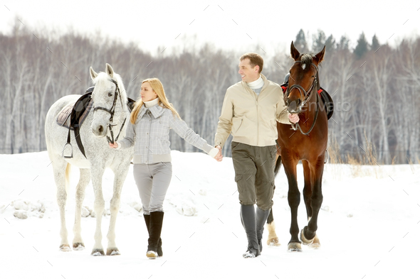 Couple of horsemen - Stock Photo - Images