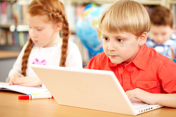 Gripping schoolwork - Stock Photo - Images