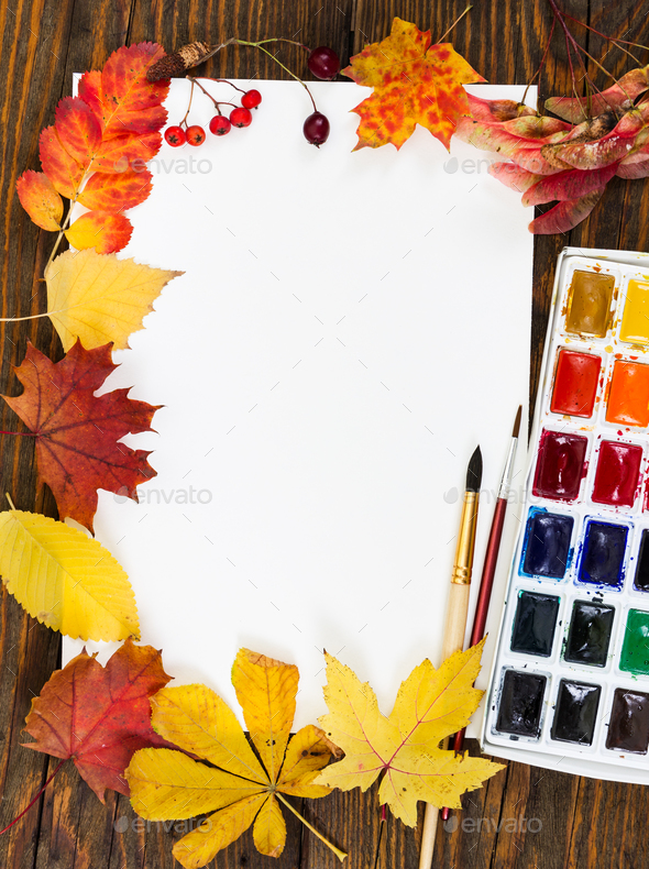 Workplace of artist. Sheet of paper, paints, brushes and autumn - Stock Photo - Images