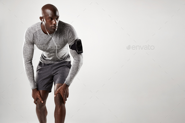 Muscular male model with armband and earphones - Stock Photo - Images