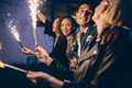 Group of friends partying and enjoying out with sparklers - PhotoDune Item for Sale