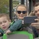 In Vienna, Austria In An Open Bus Rides a Young Family With a Little Son - VideoHive Item for Sale