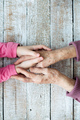 Hands of unrecognizable grandmother and her granddaughter - PhotoDune Item for Sale
