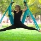 Girl In a Park Engaged In Aerial Yoga - VideoHive Item for Sale