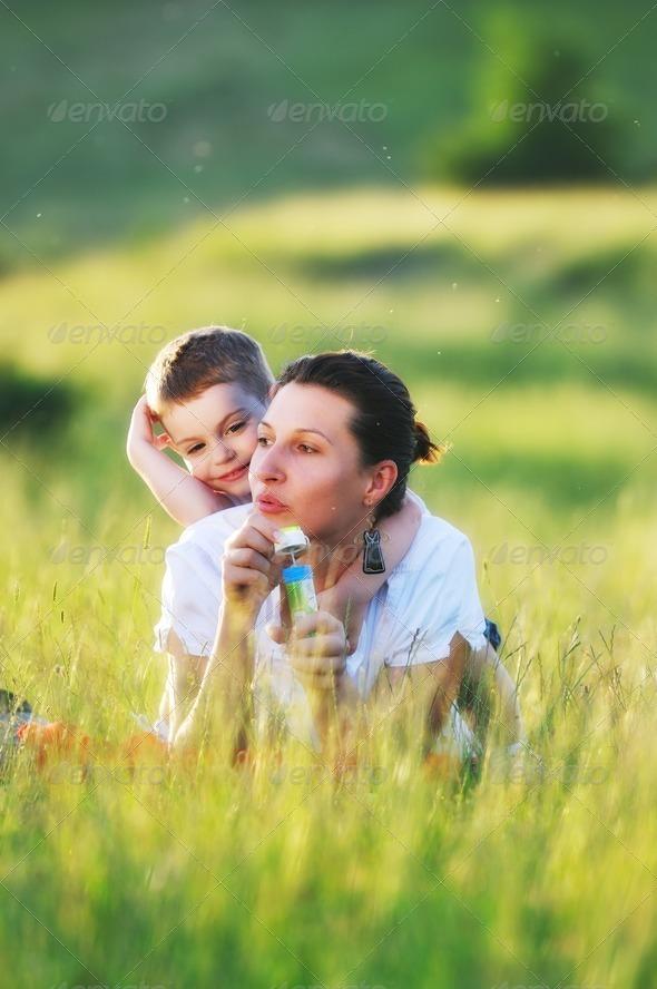 woman child bubble - Stock Photo - Images
