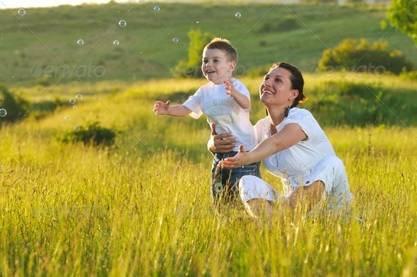 woman child bubble - Stock Photo - Images