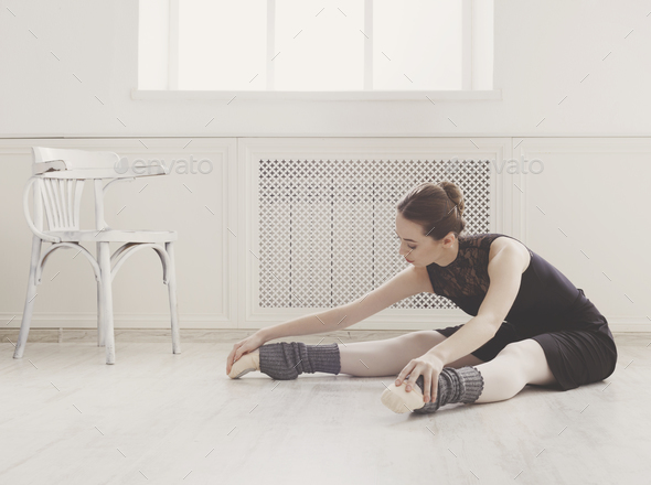 Classical Ballet dancer makes stretching in class
