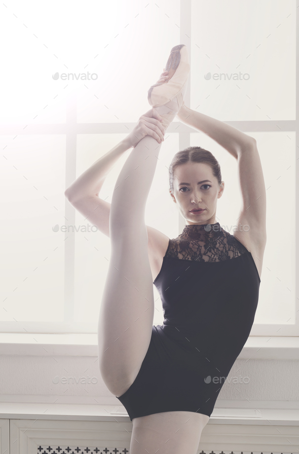 Classical Ballet dancer in split stretching, portrait