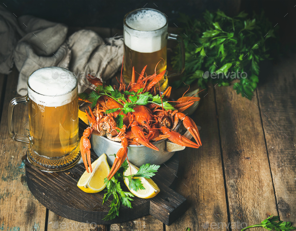 Wheat beer and boiled crayfish with lemon, fresh parsley - Stock Photo - Images