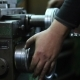 Worker Controls Adjustment Wheel Of Lathe Machine - VideoHive Item for Sale