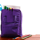 Download Open purple backpack with school supplies on wooden table. Back to . Close up. from PhotoDune