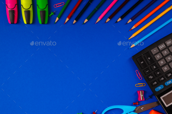 School or office stationery on blue background. Back to . Frame, copy space. Top view.  supplies - Stock Photo - Images
