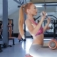 Woman Exercises on Gym Equipment at the Fitness Centre - VideoHive Item for Sale