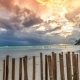 Sunset On a Background Of Fence Made Of Bamboo From The Waves On The Beach Of Boracay Island - VideoHive Item for Sale