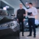 Manager Talking With Man Near Electric Car - VideoHive Item for Sale