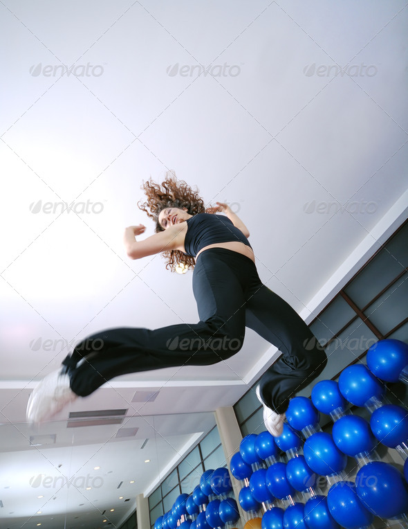Dancing woman, happy and jumping up. - Stock Photo - Images