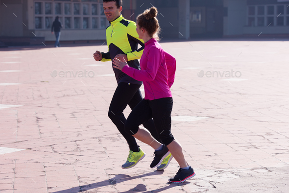 young  couple jogging - Stock Photo - Images