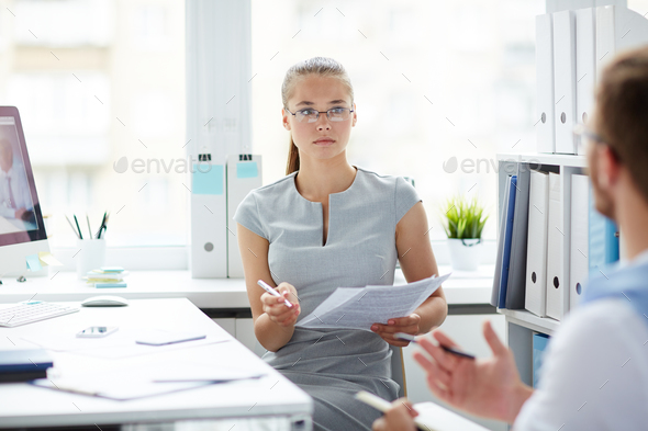 Conversation with co-worker - Stock Photo - Images