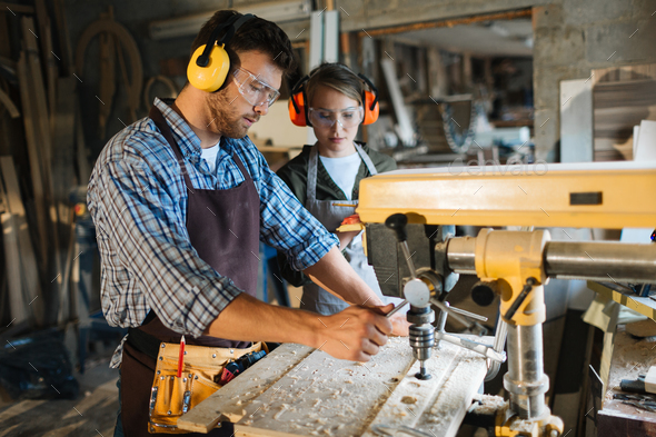 Working by drill machine - Stock Photo - Images