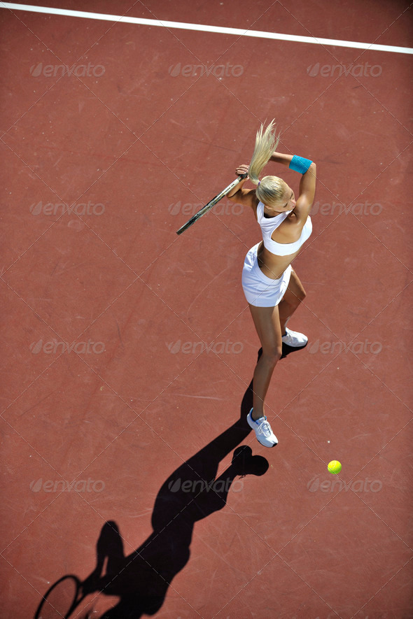 young woman play tennis outdoor - Stock Photo - Images