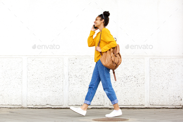 Young urban woman talking on mobile phone - Stock Photo - Images