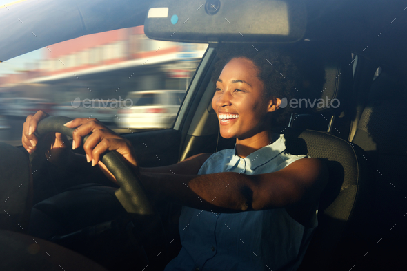 Young african american woman driving a car - Stock Photo - Images