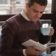Man Reads Book At The Cafe - VideoHive Item for Sale