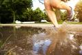 Runner sneakers with mud splash