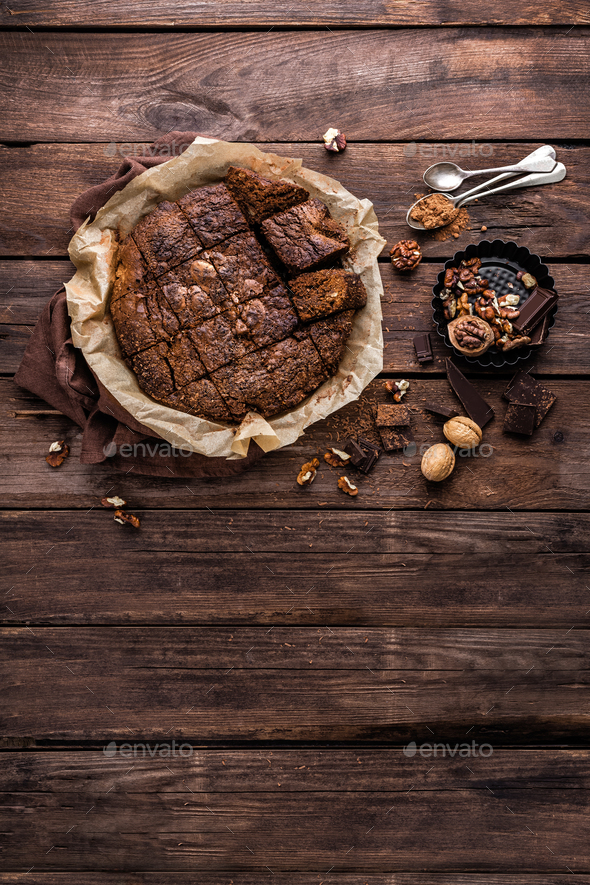 homemade chocolate brownie on dark wooden background, top view - Stock Photo - Images
