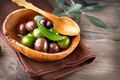 Olives and olive oil on wooden rustic table - PhotoDune Item for Sale