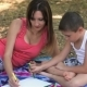 Mother With Her Son Are Drawing Pictures In The Park - VideoHive Item for Sale