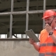 Worker With a Walkie-talkie at a Construction Site - VideoHive Item for Sale