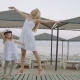 Mother Dancing With Daughter In White Dress On The Beach - VideoHive Item for Sale