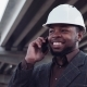Smiling Man In White Hard Hat On Phone - VideoHive Item for Sale