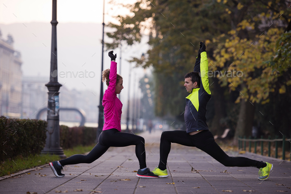 couple warming up before jogging - Stock Photo - Images
