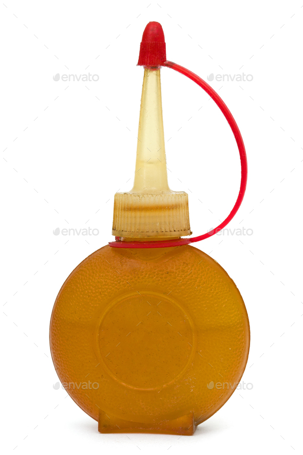 Old bottle of lubricating machine oil, isolated on white backgro - Stock Photo - Images