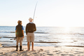 Senior man fishing with his grandson - PhotoDune Item for Sale