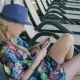 Young Woman Using Cellphone While Lying On Sunbed At Hotel - VideoHive Item for Sale