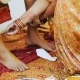 Woman Paints Legs Of Indian Groom With Curcumin - VideoHive Item for Sale