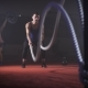 Fit Young Man Holds Rope In His Hands And Makes Heavy Rope Training Workout. - VideoHive Item for Sale