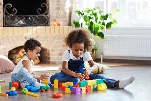 Siblings playing - Stock Photo - Images